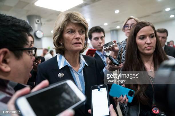 Senator Lisa Murkowski walks from the Senate subway to the Senate chamber to cast a vote in the Senate impeachment trial of President Donald Trump...