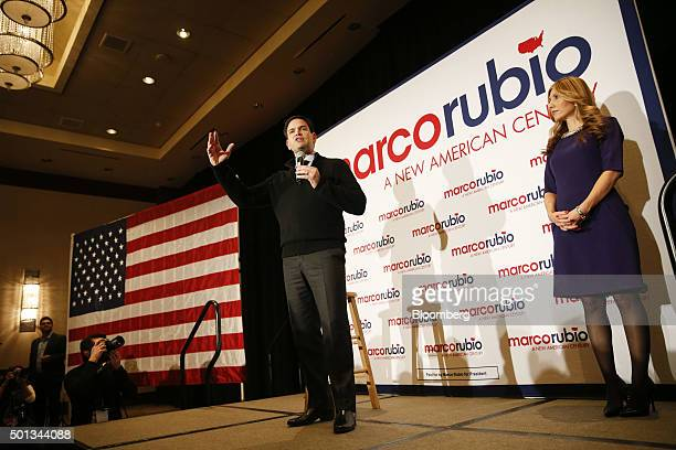 Senator Marco Rubio a Republican from Florida and 2016 presidential candidate center speaks as his wife Jeanette Dousdebes looks on during a campaign...