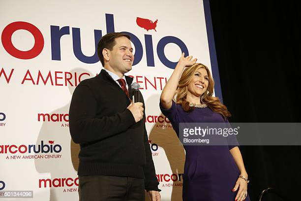 Senator Marco Rubio a Republican from Florida and 2016 presidential candidate left and his wife Jeanette Dousdebes react during a campaign rally in...