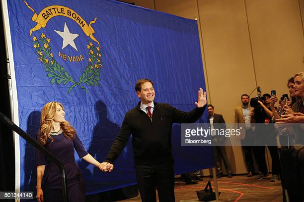 Senator Marco Rubio a Republican from Florida and 2016 presidential candidate center and his wife Jeanette Dousdebes left greet attendees during a...