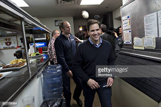 Senator Marco Rubio a Republican from Florida and 2016 presidential candidate center walks through the kitchen of Wellman's Pub and Rooftop following...