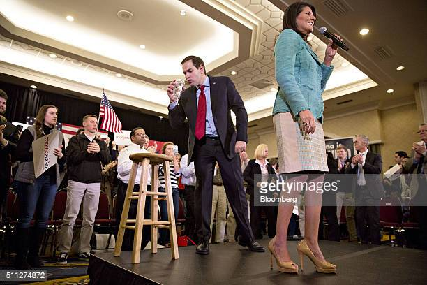 Senator Marco Rubio a Republican from Florida and 2016 presidential candidate center takes a sip of water at a campaign rally with Nikki Haley...