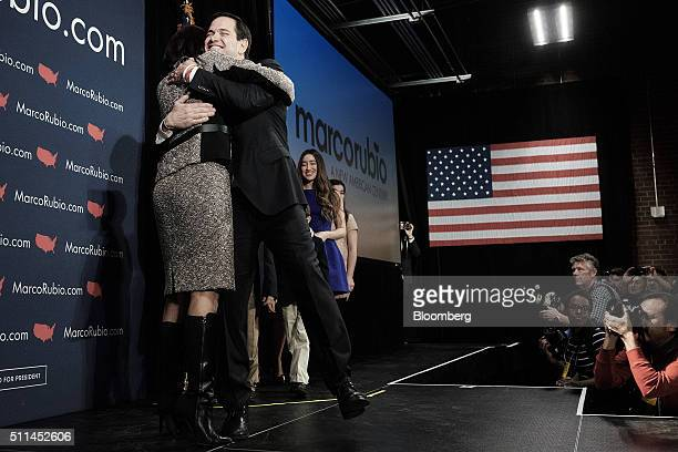 Senator Marco Rubio a Republican from Florida and 2016 presidential candidate hugs Nikki Haley governor of South Carolina left during a South...