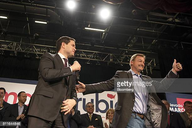 Senator Marco Rubio, a Republican from Florida and 2016 presidential candidate, left, speaks as Senator Dean Heller, a Republican from Nevada, gives...
