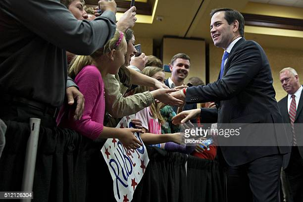 Senator Marco Rubio a Republican from Florida and 2016 presidential candidate greets attendees as he arrives to speak during a campaign rally in...