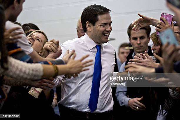 Senator Marco Rubio a Republican from Florida and 2016 presidential candidate greets attendees as he arrives to speaks during a campaign rally at...