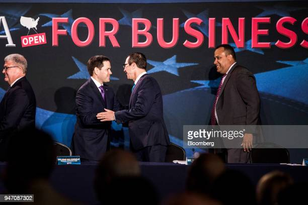 Senator Marco Rubio a Republican from Florida second left greets Steven Mnuchin US Treasury secretary center before the start of a roundtable...
