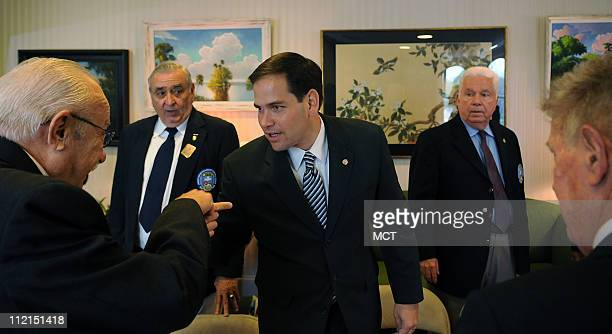 Senator Marco Rubio center hosts a lunch at the Florida House on Capitol Hill Wednesday April 13 for a small group of veterans of the Bay of Pigs who...
