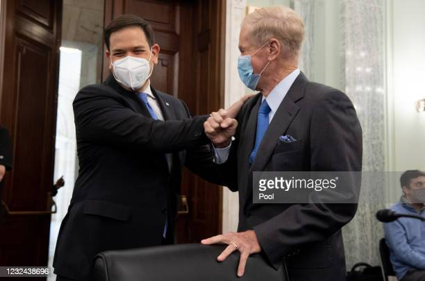 Senator Marco Rubio greets former US Senator Bill Nelson, nominee to be administrator of NASA, at a Senate Committee on Commerce, Science, and...