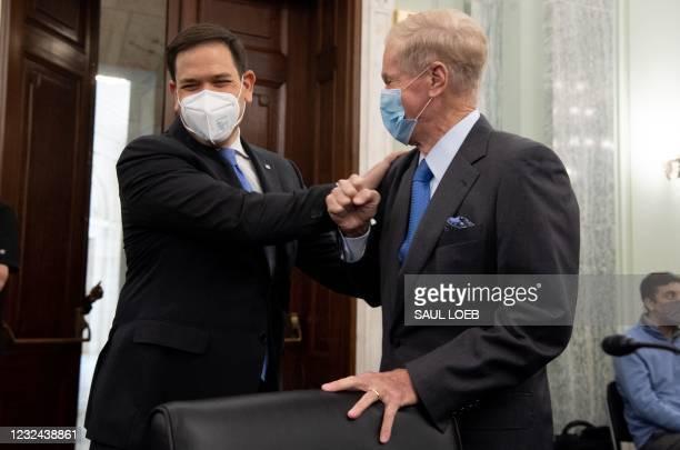 Senator Marco Rubio , Republican of Florida, greets former US Senator Bill Nelson, nominee to be administrator of NASA, prior to a Senate Committee...