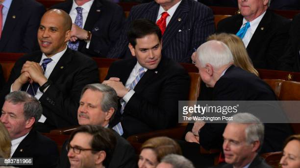 Senator Marco Rubio second from left talks with Senator John McCain at the US Capitol where President Barack Obama delivers his State of the Union...