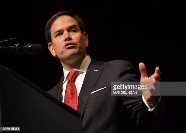 US Senator Marco Rubio speaks before the arrival of US President Donald Trump at the Manuel Artime Theater in Miami Florida on June 16 2017 US...