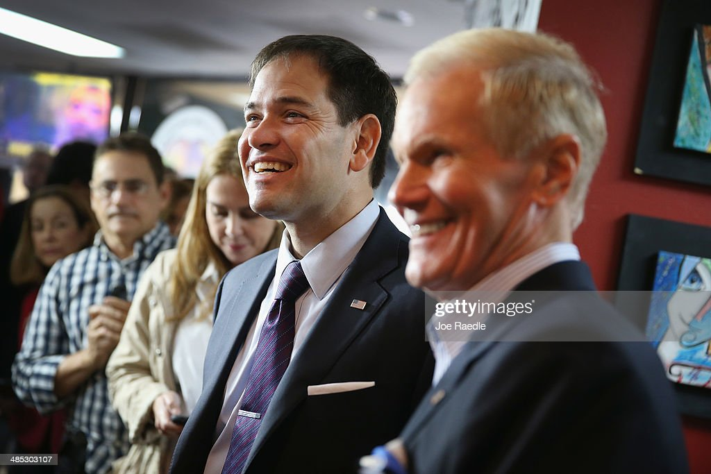 U.S. Senator Marco Rubio (R-FL) stands with Sen. Bill Nelson (D-FL) before they held a press conference to show support for the Venezuelan community at the El Arepazo 2 Restaurant on April 17, 2014 in Doral, Florida. The Senators spoke about the need for the United States to support the opposition in Venezuela against Venezuelan President Nicolas Maduro.