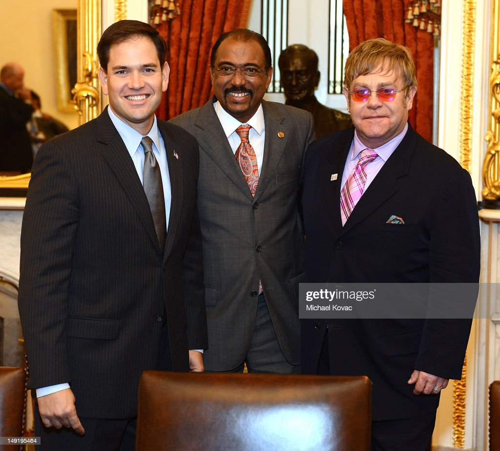 U.S. Senator Marco Rubio (R-FL), UNAIDS Executive Director Michel Sidibe, and Sir Elton John meet after The Elton John AIDS Foundation and UNAIDS breakfast at the Russell Senate Office Building on July 24, 2012 in Washington, DC.