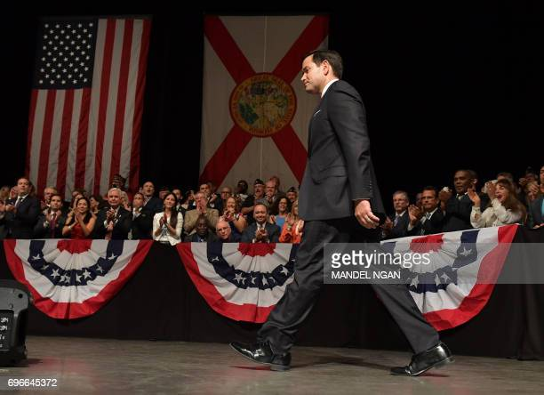 US Senator Marco Rubio walks to the podium to speak before the arrival of US President Donald Trump at the Manuel Artime Theater in Miami Florida on...