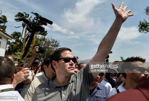 US senator Marco Rubio waves to people as he walks at the Simon Bolivar international bridge in Cucuta Colombia border with San Antonio de Tachira...
