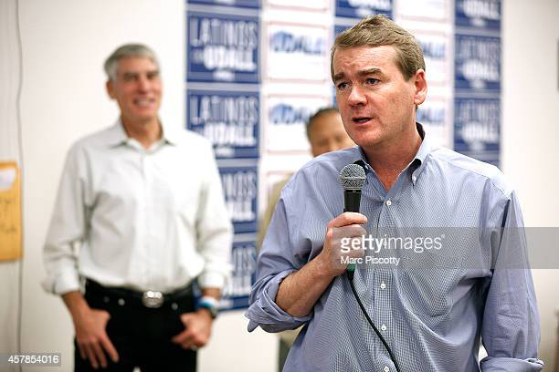 S Senator Mark Udall background was joined by fellow US Senator Michael Bennet right at a canvass kickoff campaign on October 25 2014 in Thornton...