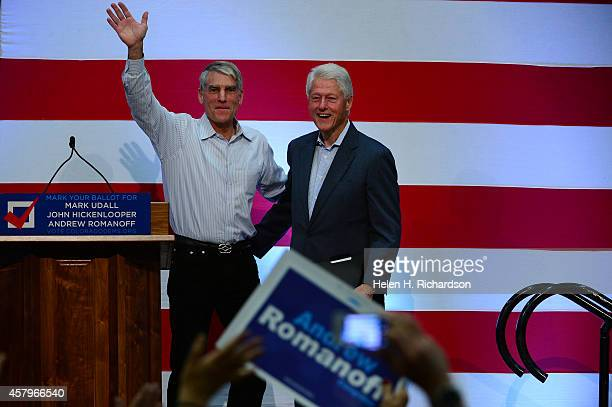 Senator Mark Udall introduces former president Bill Clinton, right, as he takes center stage to speak to a packed audience during a get-out-the-vote...