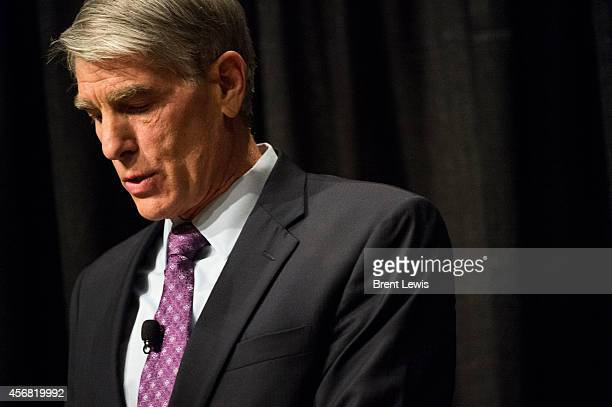 October 7: U.S. Senator Mark Udall jots notes during U.S. Representative Cory Gardner's turn to speak during a debate Tuesday, October 7, 2014 in the...