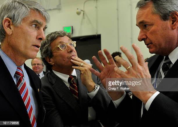 U S Senator Mark Udall talks with Orion Deputy Program Manager Laurence Price and Orion Assembly Test and Launch Operations Manager Jim Kemp of...