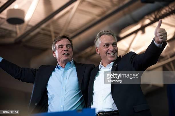 Senator Mark Warner a Democrat from Virginia left and Terry McAuliffe Democratic nominee in the 2013 Virginia gubernatorial election wave to...