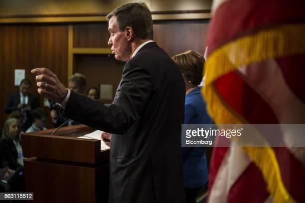 Senator Mark Warner a Democrat from Virginia speaks as Senator Amy Klobuchar a Democrat from Minnesota listens during a press conference introducing...