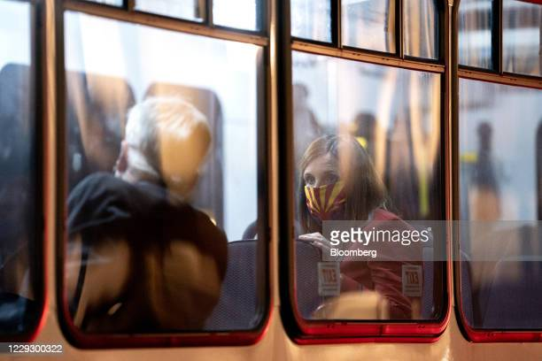 Senator Martha McSally, a Republican from Arizona, right, wears a protective mask while sitting on a bus at the U.S. Capitol, bound for the White...