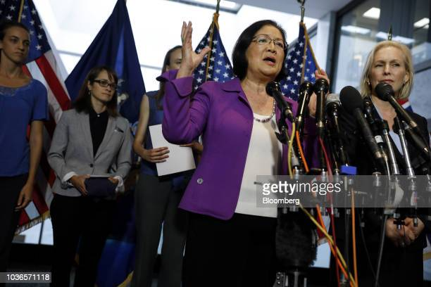 Senator Mazie Hirono a Democrat from Hawaii speaks as Senator Kirsten Gillibrand a Democrat from New York right listens during a news conference with...