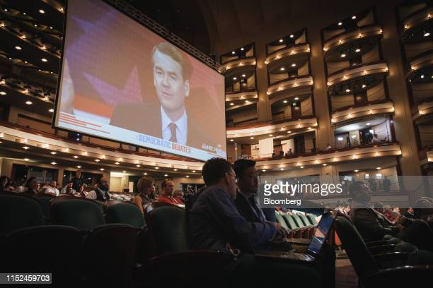Senator Michael Bennet a Democrat from Colorado and 2020 presidential candidate is shown on a screen as members of the media work during the...