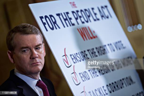 Senator Michael Bennet a Democrat from Colorado listens during a news conference on For The People Act at the US Capitol in Washington DC US on...