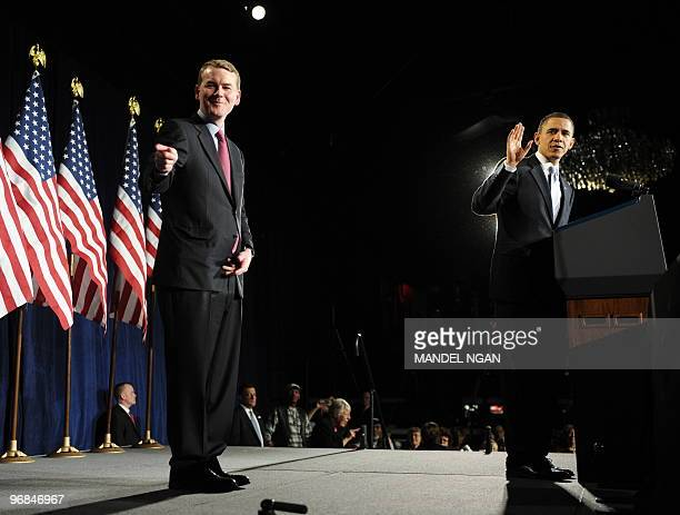 Senator Michael Bennet and US President Barack Obama gestures towards Bennet's daughter during a grassroots fundraiser for Bennet February 18 2010 at...
