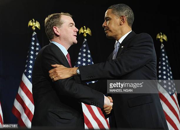 Senator Michael Bennet [DCO] shakes hands with US President Barack Obama following a grassroots fundraiser for Bennet on February 18 2010 at the...