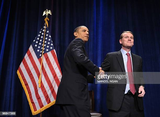 Senator Michael Bennet [DCO] shakes hands with US President Barack Obama during fundraising reception for Bennet on February 18 2010 at the Sheraton...