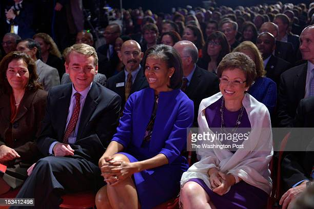 Senator Michael Bennet First Lady Michelle Obama and Valerie Jarrett Senior Advisor to President Obama wait patiently with dozens of people in the...