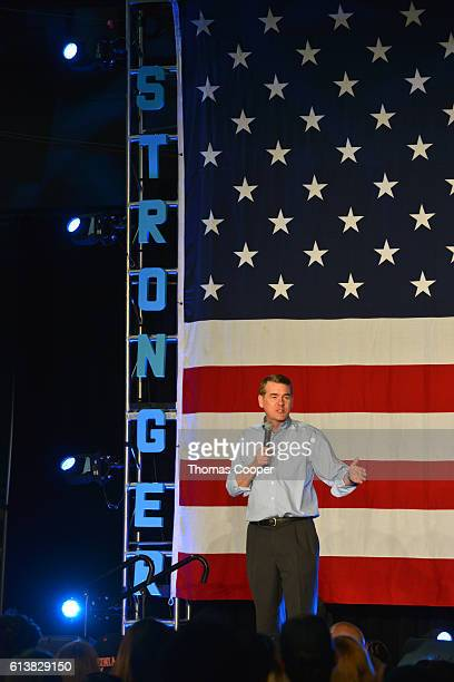Senator Michael Bennet speaks before a rally with Dave Mathews Band and Tim Kaine at National Western Complex on October 10 2016 in Denver Colorado