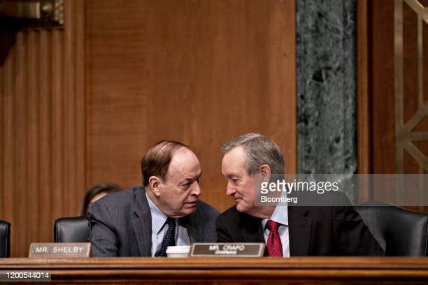 Senator Mike Crapo a Republican from Idaho and chairman of the Senate Banking Committee right talks to Senator Richard Shelby a Republican from...