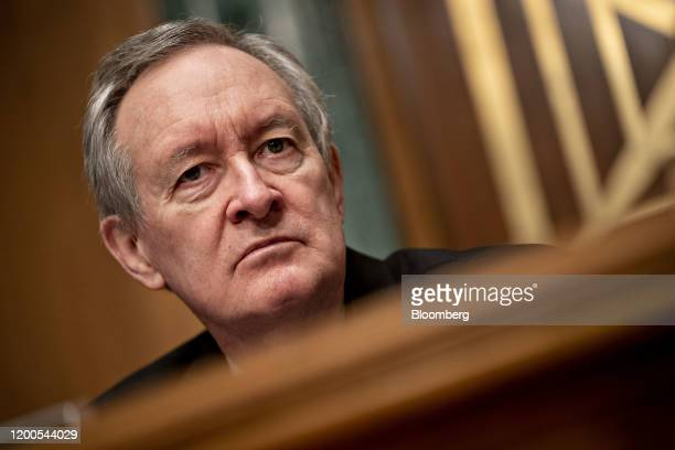 Senator Mike Crapo a Republican from Idaho and chairman of the Senate Banking Committee listens during a confirmation hearing in Washington DC US on...