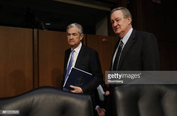 Senator Mike Crapo a Republican from Idaho left and Jerome Powell chairman of the US Federal Reserve nominee for US President Donald Trump arrive to...