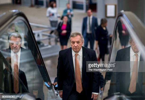 WASHINGTON DC Senator Minority Whip Dick Durbin walks to the Senate floor while being questioned by journalists during a day with a government...