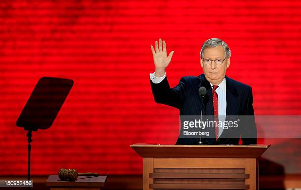 Senator Mitch McConnell a Republican from Kentucky waves while speaking at the Republican National Convention in Tampa Florida US on Wednesday Aug 29...
