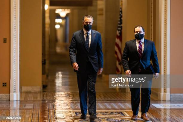 Senator Mitt Romney, a walks through the halls of Capitol Hill on his way to the Senate chamber on Tuesday, Jan. 26, 2021 in Washington, DC.