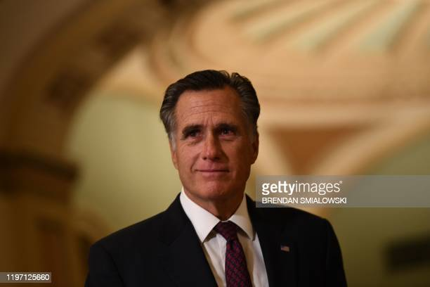 Senator Mitt Romney walks outside the Senate chamber during a recess in the impeachment trial against President Donald Trump at the US Capitol on...