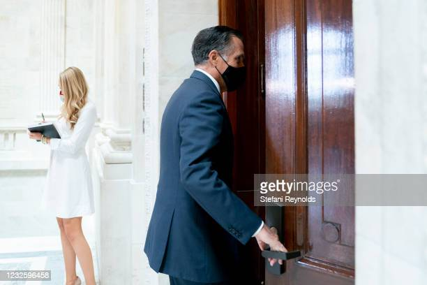 Senator Mitt Romney wears a protective mask while arriving to Senate Republican policy luncheon at the Russell Senate Office Building on April 29,...