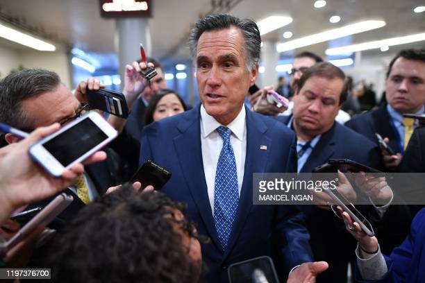 Senator Mitt Romneyspeaks to the media as he arrives during the impeachment trial of US President Donald Trump on Capitol Hill January 29 in...
