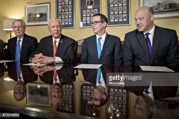 Senator Orrin Hatch a Republican from Utah and chairman of the Senate Finance Committee second left speaks as Gary Cohn director of the US National...