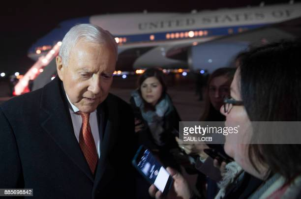 US Senator Orrin Hatch Republican of Utah speaks with the press after arriving with US President Donald Trump on Air Force One at Andrews Air Force...