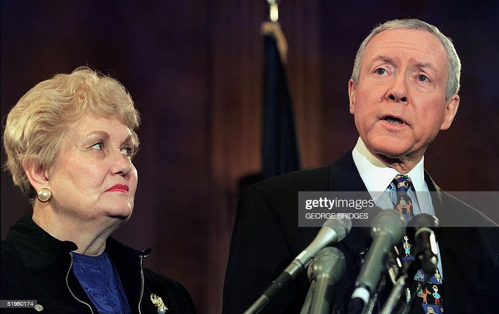 US Senator Orrin Hatch, R-UT, speaks to reporters as his wife Elaine (L) looks on during a press conference 26 January, 2000, on Capitol Hill in Washington, DC. Hatch announced that he is withdrawing from the race for the Repubican presidential nomination, after finishing last in the Iowa caucuses. Hatch told reporters that he will endorse GOP front-runner George W. Bush.