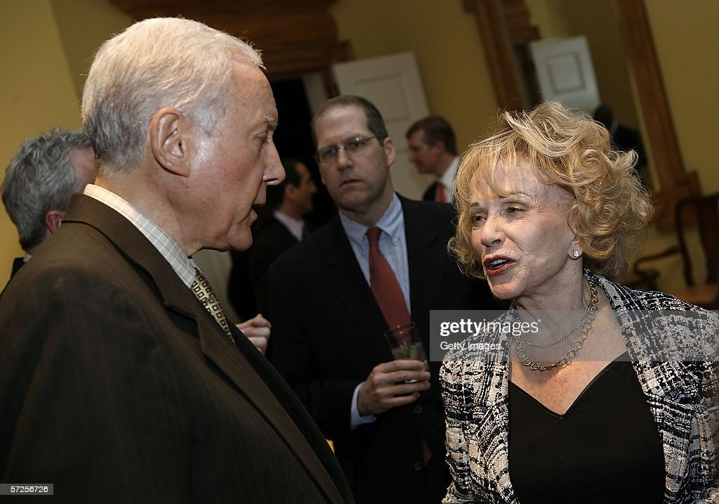 Senator Orrin Hatch (L)(R-UT) speaks with Mary Margaret Valenti, wife of former MPAA President Jack Valenti during a reception held at the MPAA by Friends of the Global Fight April 4, 2006, in Washington, DC.