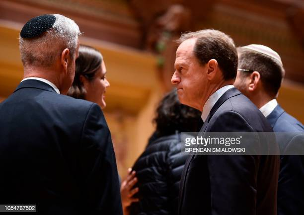 Senator Pat Toomey speaks with Rabbis after a vigil to remember the victims of the shooting at the Tree of Life synagogue the day before at the...