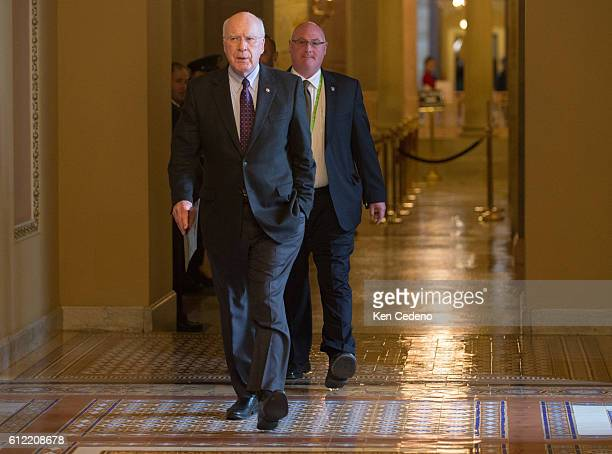 Senator Patrick Leahy walks toward the Senate floor on Capitol Hill December 31 2012 in Washington DC while Congressional Leaders try to work out a...